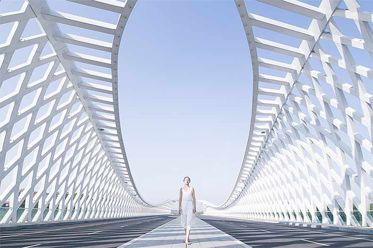 A dancer in the center of a bridge