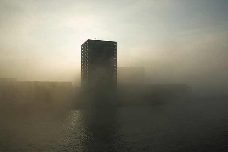 A rectangular building appearing in fog