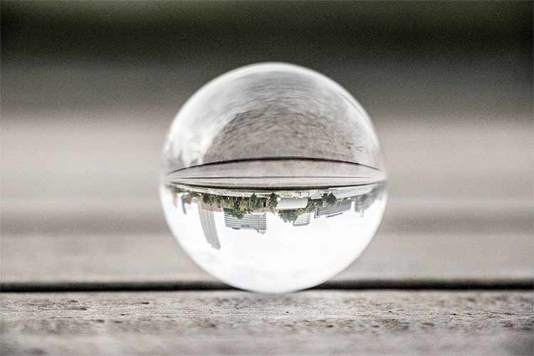 A city skyline reflected upside-down in a glass ball