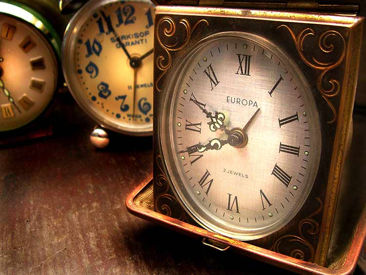 A close-up HDR photograph of clocks on a desk