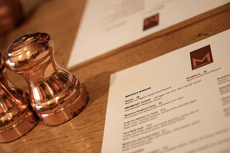 Restaurant menus with brass salt shakers