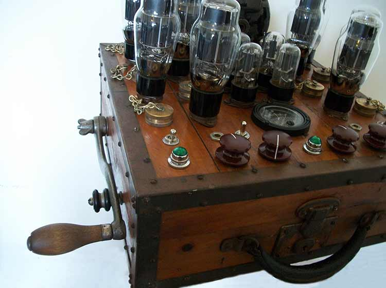 A crank-wound wooden box with an array of tube amplifiers