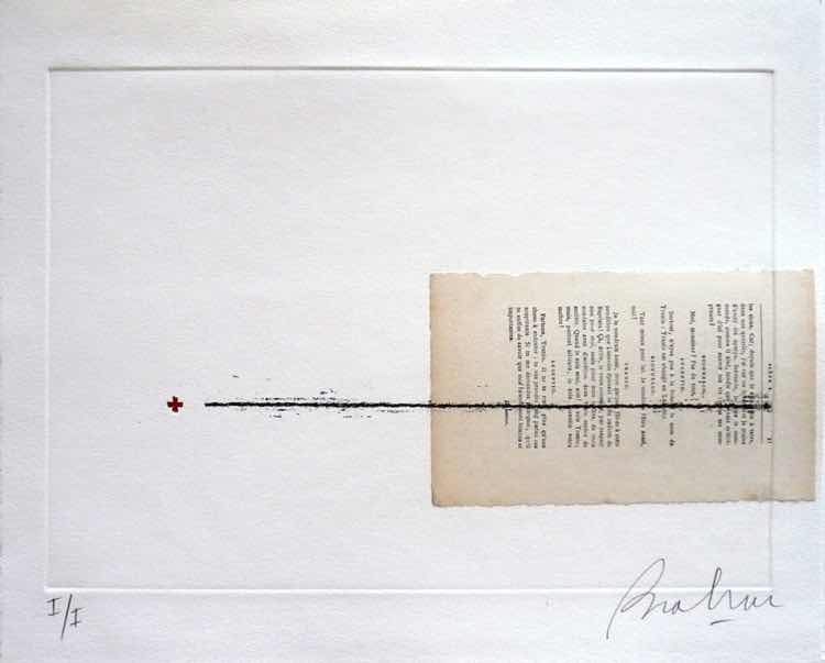 A typewritten page, displayed on its side in a frame, with a black line through it
