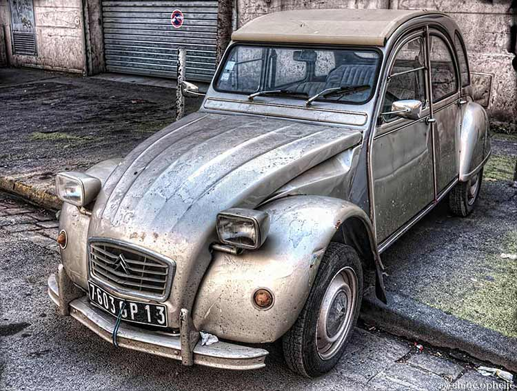 HDR Photograph of a battered silver Citroën 2CV