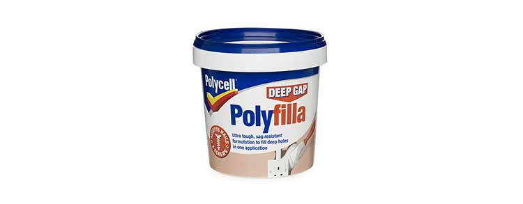 A photograph of a tub of Polyfilla