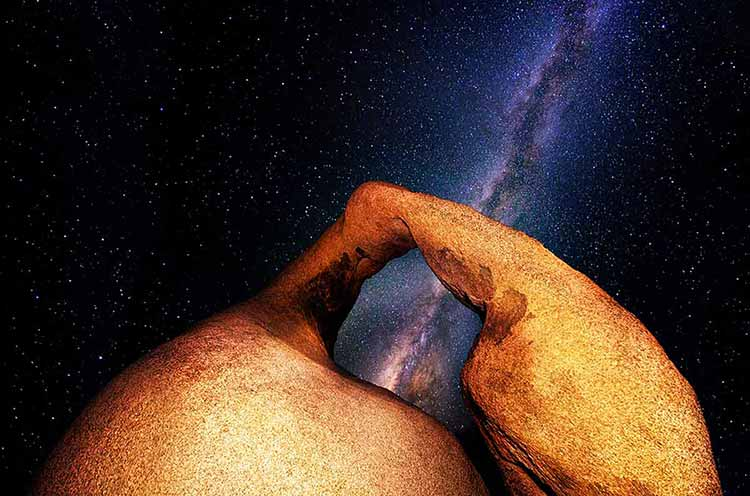 Photograph of the Milky Way seen through a rock arch