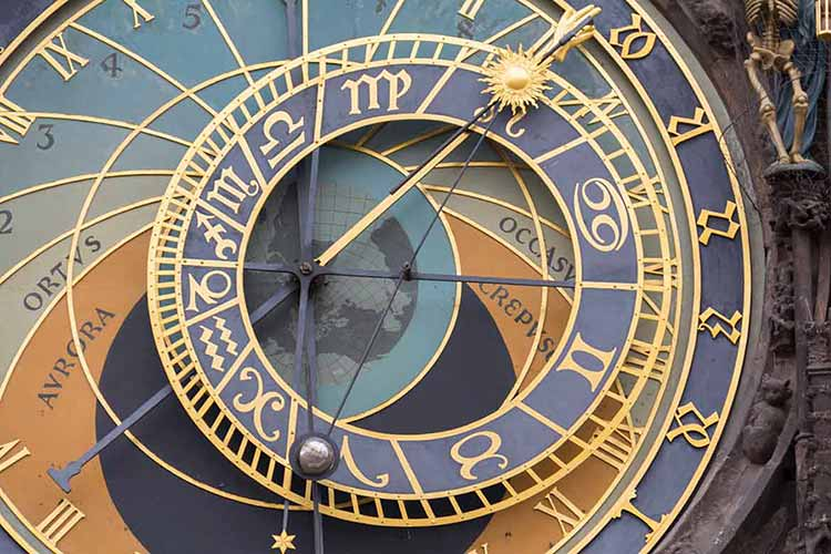 Photograph of the blue and gold face of an astronomical clock in Prague