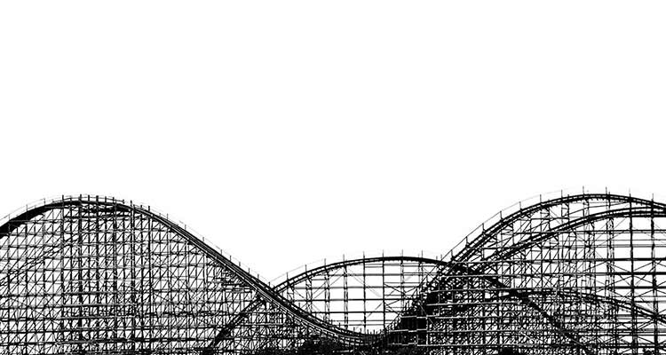 Black and white photograph of the loops of a wooden rollercoaster