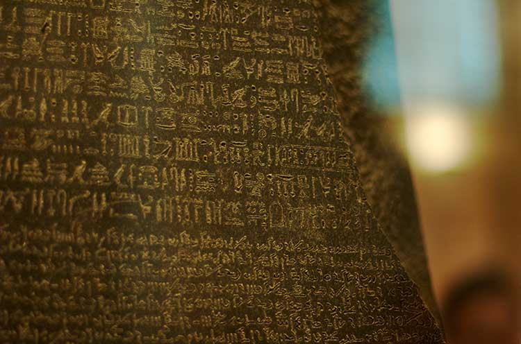 A photograph of the Rosetta Stone, showing Egyptian herioglyphs