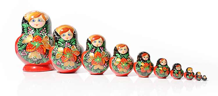 A row of brightly decorated Russian nesting dolls