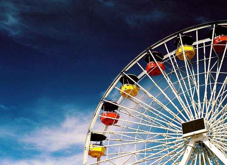 A ferris wheel photographed against a bright blue sky
