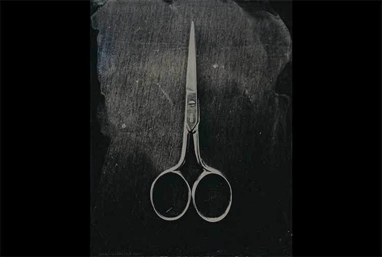 A pair of small scissors, shot in black and white