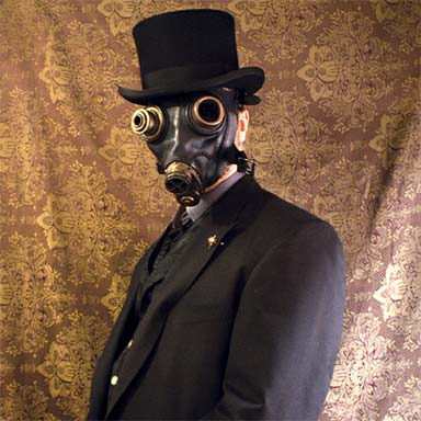 Gentleman wearing a steampunk gasmask and top hat