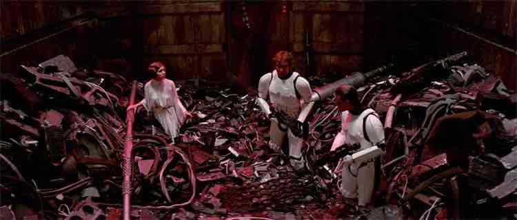 Still from the movie Star Wars showing the heroes inside the Death Star trash compactor.